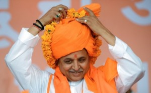 VHPVishwas Hindu Parishad (VHP) International Working President, Pravin Togadia adjusts a garland while taking part in the launch of the 'Hindu Ahead' Movement in Ahmedabad on March 31, 2013. Rashtriya Swayam Sewak (RSS) Chief, Mohan Ji Bhagwat inaugurated the 'Hindu Ahead' Movement in the presence of VHP International Working President, Pravin Togadia. 'Hindu Ahead' Movement was launched for the security and prosperity of the Hindus. AFP PHOTO / Sam PANTHAKY