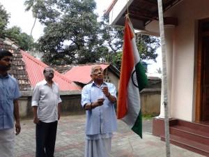 P Parameshwaran hoisting National Flag