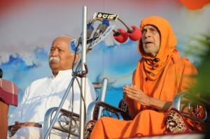 FILE PHOTO: Pejawar Seer with RSS Chief Mohan Bhagwat at Hindu Shakti Sangam of Hubli-2012
