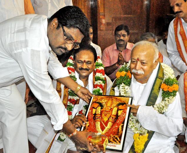 RSS chief Mohan Bhagwat and Narsapuram MP Gokaraju Gangaraju being given temple honours at Kanaka Durga temple in Vijayawada on Friday.