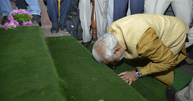 BJP's Prime Minister designate, Narendra Modi, bows down while entering the Parliament House in New Delhi on Tuesday. Photo Courtesy: Rajeev Bhatt, The Hindu