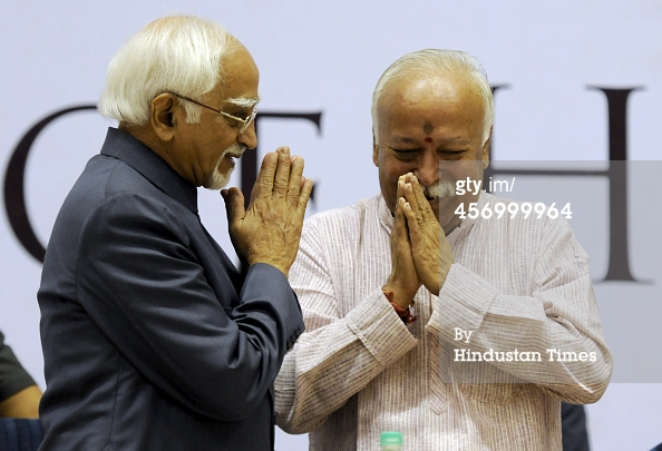 NEW DELHI, INDIA - OCTOBER 10: Vice President M Hamid Ansari and RSS Chief Mohan Bhagwat greets each other during the release of International edition of the Encyclopedia of Hinduism at Vigyan Bhawan on October 10, 2014 in New Delhi, India. (Photo by Sonu Mehta/Hindustan Times)