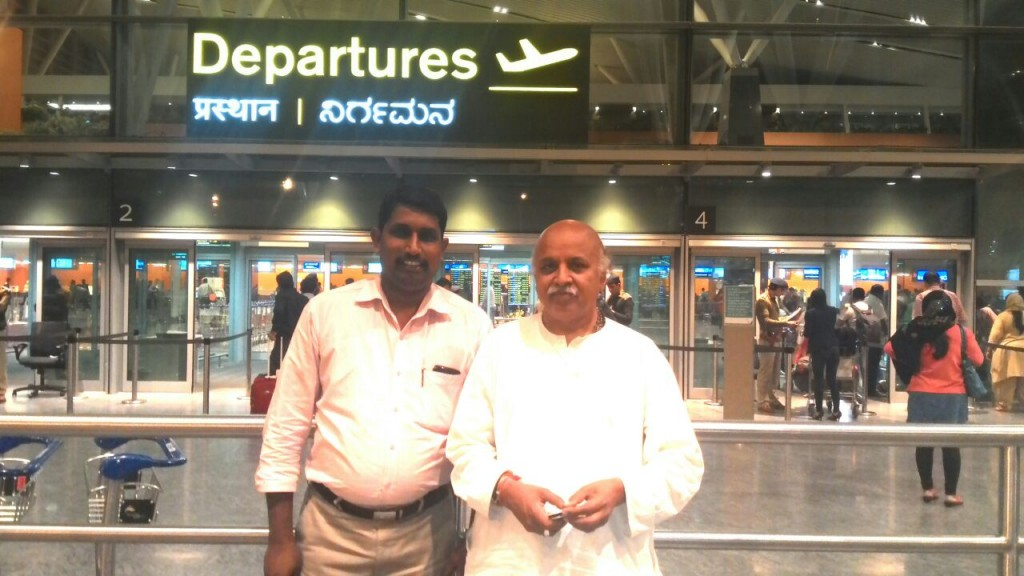 Dr Pravin Togadia with Rajesh Padmar at early morning on February 08-2015 at Bengaluru Airport.