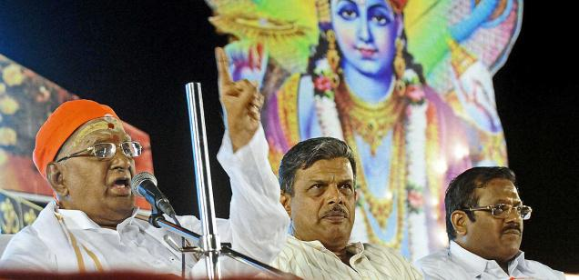 Ramagopalan (left), founder-leader of Hindu Munnani, speaking at the state conference in Coimbatore on Sunday. Rashtriya Swayamsevak Sangh Joint General Secretary Dattatreya Hosabale (second right) is in the picture. Photo Courtesy :The Hindu