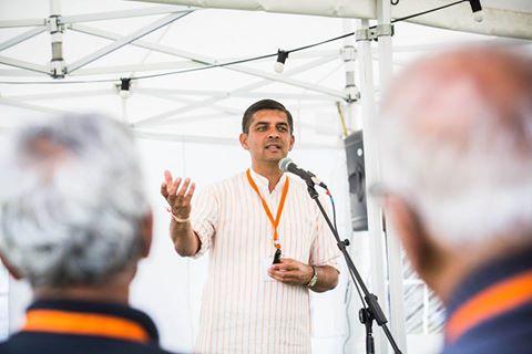 "Saumitra Gokhale, Hindu Swayamsevak Sangh USA, giving a talk on ""What after Higgs Boson?"