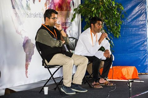 """Manoj Ladwa, Chief Executive of MLS Chase, UK, and Shri Sachin Nandha of WeComeOne, giving a talk on """"Dharmic Capitalism"""""""