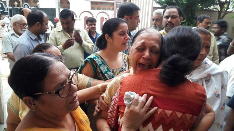 Gagneja's wife, Sudesh, cries at their residence in Jalandhar Cantt on Thursday.
