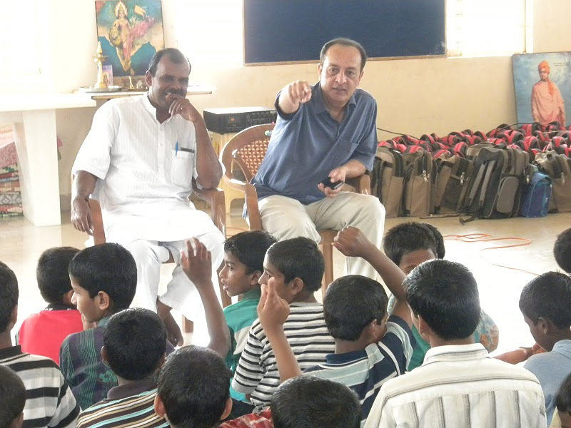 Music director Mano Murthy interacts with NELE students, a centre for homeless children